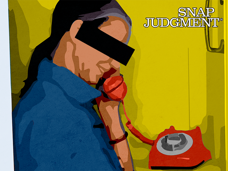 An anonymous person on a the phone in a phone booth.