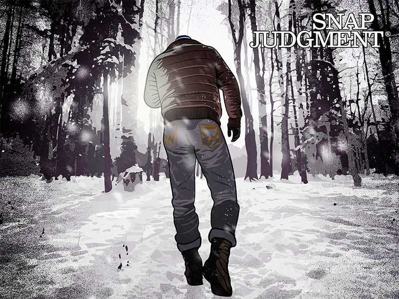 A man walking in the woods. The ground is covered in snow.